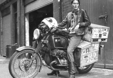 <h3>An adventure pioneer</h3>How did Elspeth Beard became the first Englishwoman to ride a motorcycle around the world? While she is studying archaeology in England, Elspeth starts to feel like discovering other places. With her BMW R 60/6, which she works on alone in her garage, she travels through Ireland and Scotland, then mainly Europe. In the first two years of her bike ownership, she will rack up over 10,000 miles. This spirit of discovery will never leave her from then on, instead it starts to grow...and it grows big! It's decided: she will go travel the world after her third year of university. To get the necessary funds to carry out her project, she works in the bar of her university in the evening, after classes. After having saved enough money, she gears up and takes off to the Big Apple.
