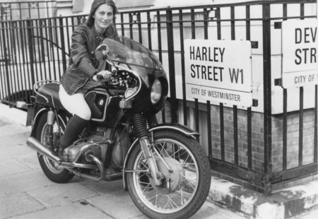 """<h3>From America to Oceania</h3>Driving her faithful motorcycle, she discovers Canada before continuing her <a href=""""http://www.vintagerides.travel/"""">motorcycle tour</a> through the United States to reach Mexico. From there, she heads back up North to Los Angeles from where she embarks on a ferry across the Pacific to get to Sydney. Her bike joins few days later. She spends seven months in Sydney. Along with the development of an architectural project as part of her studies, she lives in a garage and blossoms discovering the Australian roads. This time allows her to replenish her diminished funds. After a two weeks stay at the hospital due to an accident, she doesn't give up and continues her trip in Australia. She still has the Bell 'bone dome' helmet that she's convinced saved her life (and which she carried on wearing for the rest of the trip!). Her thirst for discovery strongly increases."""
