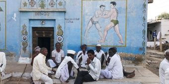 south india village wrestler mural painting