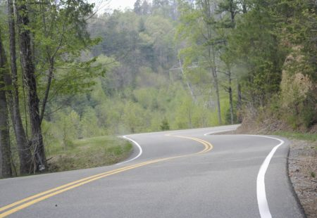 <h2> 5) Deal's Gap in Tennessee </h2>Imagine riding a motorcycle along a dragon's tail. You're turning left, your turning right, you're leaning left, you're leaning right. That's what Deal's Gap feels like, hence the nickname, Tail of the Dragon. Close to the border of The Great Smoky Mountains National Park, The Dragon is extremely challenging and full of curves. 318 curves along 11 miles to be exact. You're sideways pretty much the whole time! Ride along vibrant forest and green mountains. Challenging for beginners and experts, Deal's Gap will keep you on your toes the whole time.