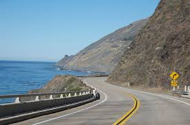 <h2> 1) Pacific Coast Highway in California </h2>We saved the best for last. Soak up the sun along one of the most famous ocean drives in the world. A more than 600-mile journey takes you through beautiful destinations like San Diego, Los Angeles, Big Sur, Monterey, and San Francisco. Widely renowned as one of the most beautiful motorcycle roads in America, the PCH hugs tall rugged cliffs on California's coastline. Experience sheer drop-offs, hairpin turns, sparkling blue ocean, and often even heavy morning fog on this narrow two-lane highway. Highway 1 has both challenging stretches that keeps riders on their toes and more relaxed areas that feel like easy ridin'. Ride through ancient coastal redwood forest and hear the crash of waves as you check this ride off your bucket list.